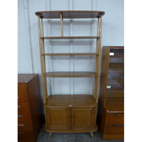 106 - An Ercol Blonde room divider...