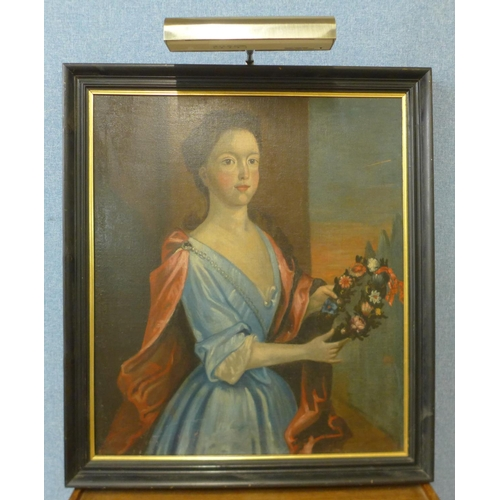 2 - A portrait of an 18th-century lady holding flowers, oil on canvas, unsigned...