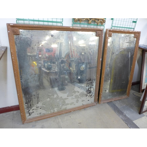 23 - Two simulated oak framed mirrors...