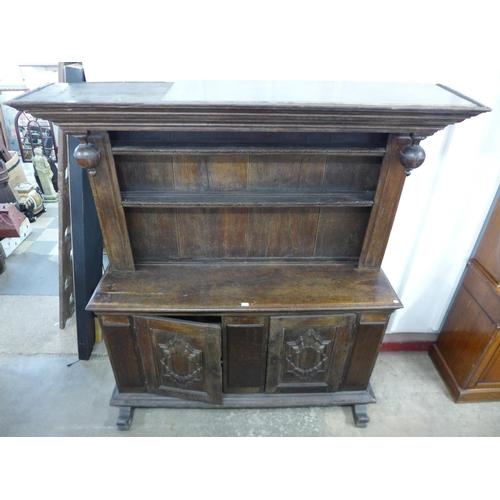 27 - A French carved oak dresser...