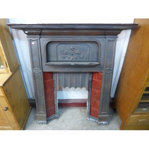 28 - An Art Nouveau cast iron fire insert...