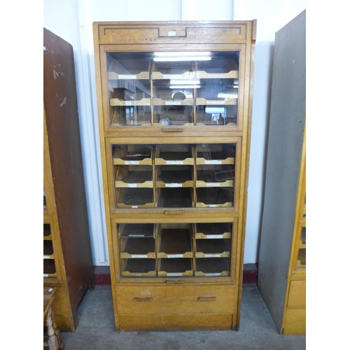 31 - A mid 20th Century oak haberdashery shop cabinet...