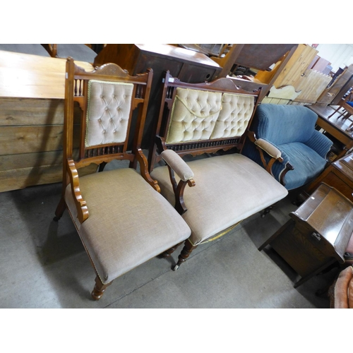 33 - A Victorian mahogany and upholstered salon settee and armchair...
