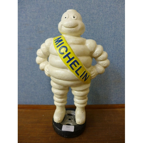 343 - A reproduction cast iron Michelin Man figure...