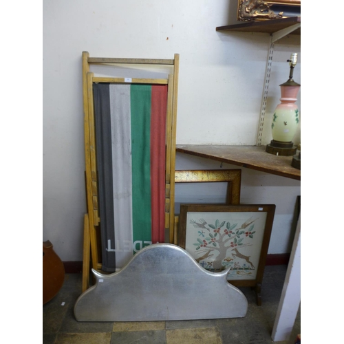 346 - A deck chair, fire screen, table top and a frame...
