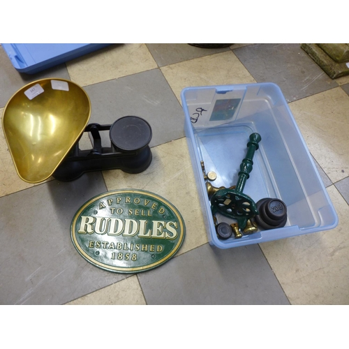 347 - A set of Salter kitchen scales and weights, a Ruddles metal plaque and a doorstop...