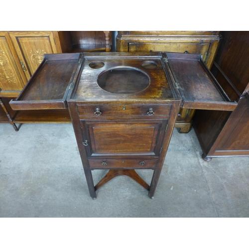 39 - A George III mahogany washstand...