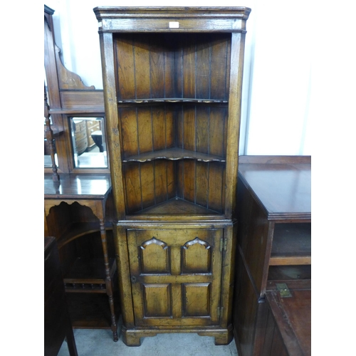 40 - An oak corner cupboard...