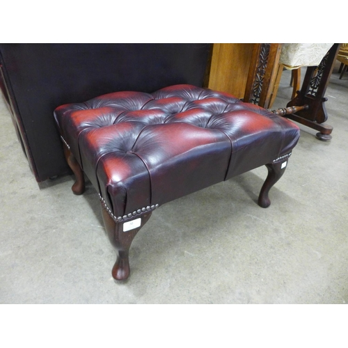 70 - A red leather Chesterfield footstool...