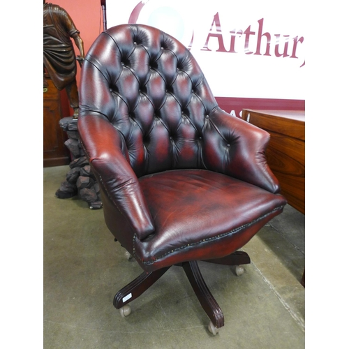 93a - A red leather swivel office chair...