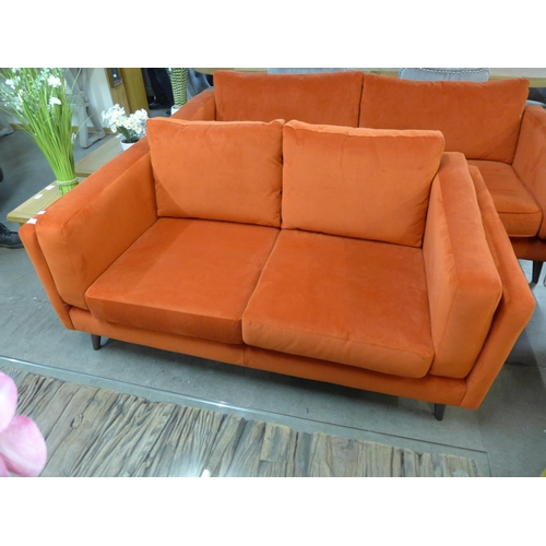 1307 - An orange velvet two seater sofa...
