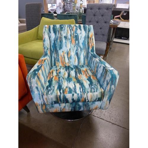 1309 - A blue and orange velvet swivel chair...