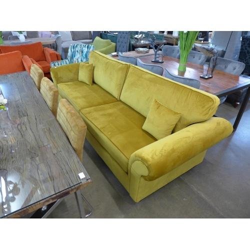 1310 - A mustard yellow velvet Lila four seater sofa...