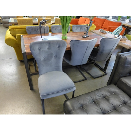 1311 - A fire dining table and six Arjun grey velvet chairs...