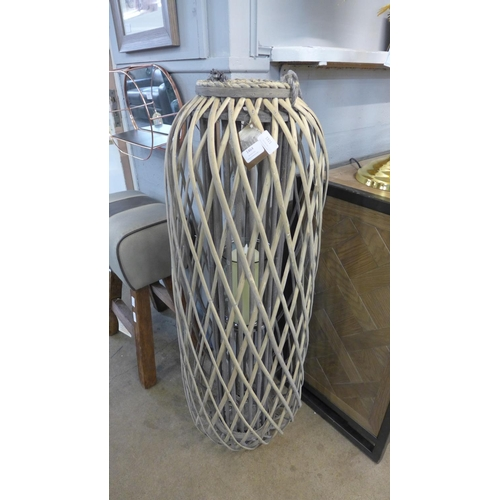 1321 - A large floorstanding wicker lantern with candle (1873027)   #...