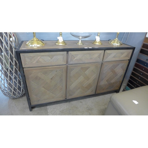1322 - A parquetry oak and steel sideboard...