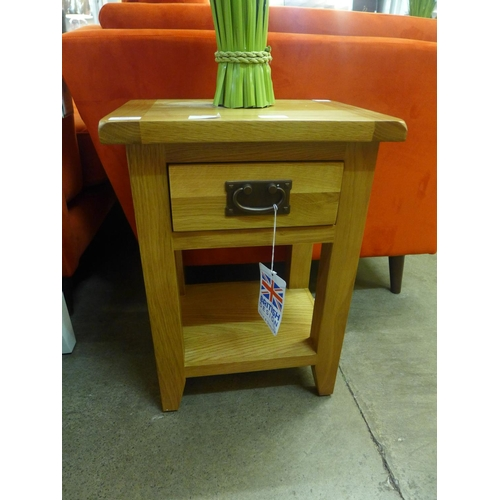 1366 - A rustic oak one drawer small lamp table (NC-SIT-OAK)  *This lot is subject to vat...