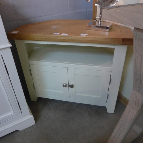1393 - A Hampshire ivory corner TV unit (KEL P21)  *This lot is subject to vat - crack on front...