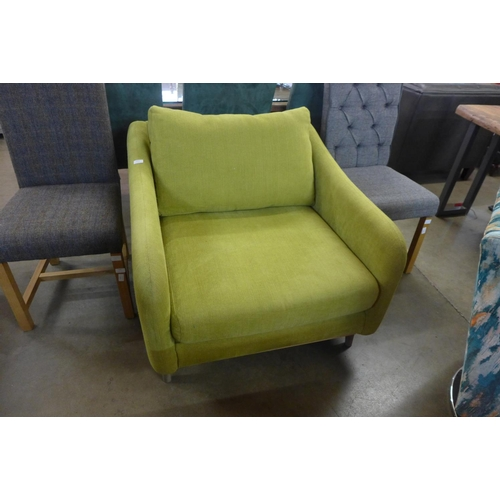1412 - A green upholstered armchair (one of the rear legs not matching)...