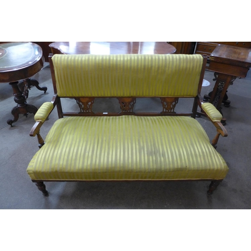 62 - An Edward VII inlaid rosewood and upholstered salon settee...
