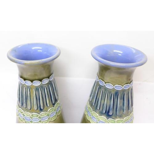 606 - A pair of Royal Doulton Art Deco vases, Florrie Jones, 31cm...
