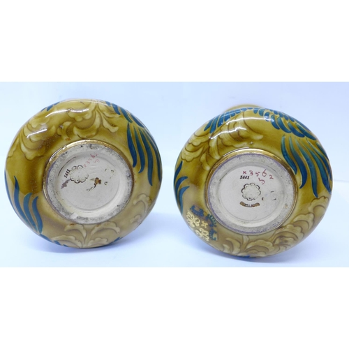 608 - A pair of Doulton Lambeth Art Nouveau vases, circa 1890-1900, decorated with phoenix in foliage, A. ...