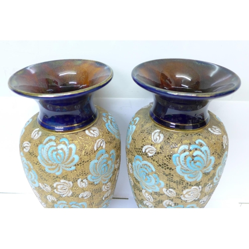 612 - A pair of Royal Doulton Slaters Patent vases, decorated by Sarah Ellis, 28cm...