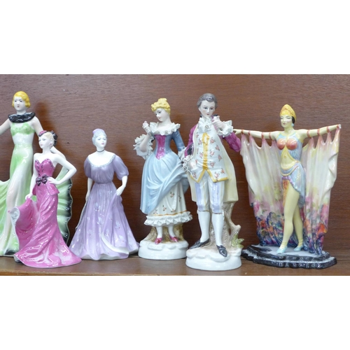 615 - A pair of continental figures, two Royal Worcester figures, two Coalport figures and two others, one...