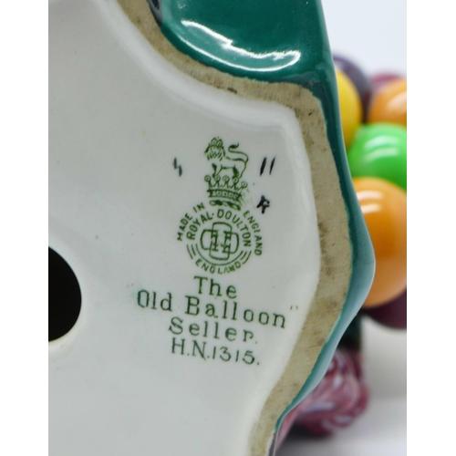 618 - A Royal Doulton figure, The Old Balloon Seller, HN1315...
