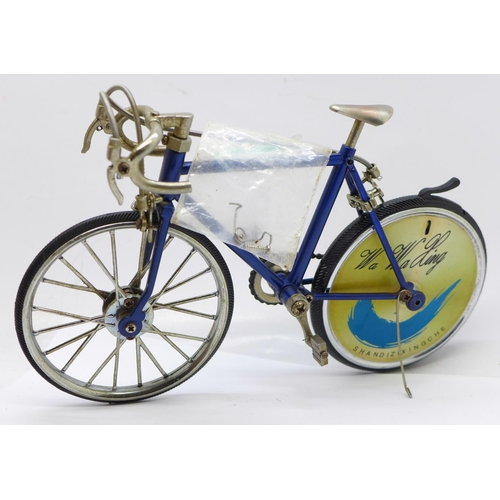 632 - A novelty model metal racing bicycle with cigarette lighter in the rear wheel, circa 1970's (back br...