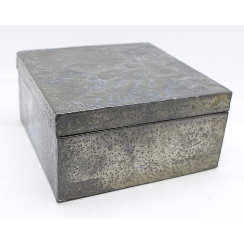 656 - An Art Nouveau hammered pewter jewellery box...