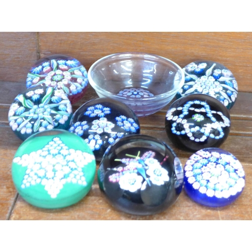 659 - Eight John Deacons glass paperweights and a dish...