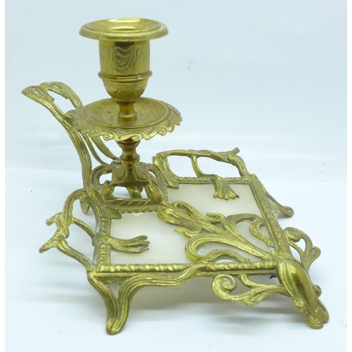 665 - An Art Nouveau gilt metal and alabaster candle holder...