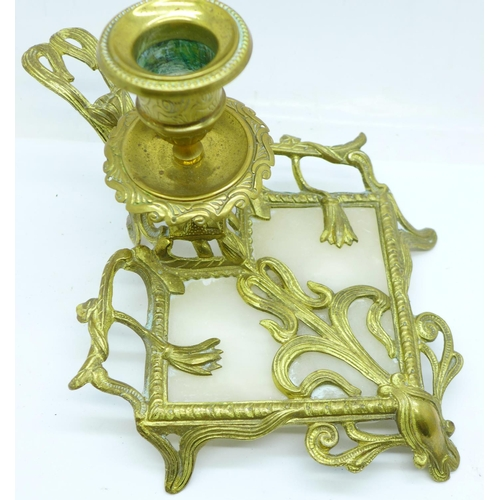 665 - An Art Nouveau gilt metal and alabaster candle holder