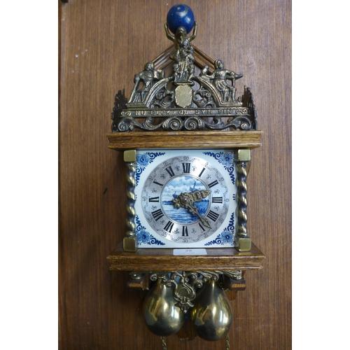 28 - A Dutch oak and brass double weight wall clock...