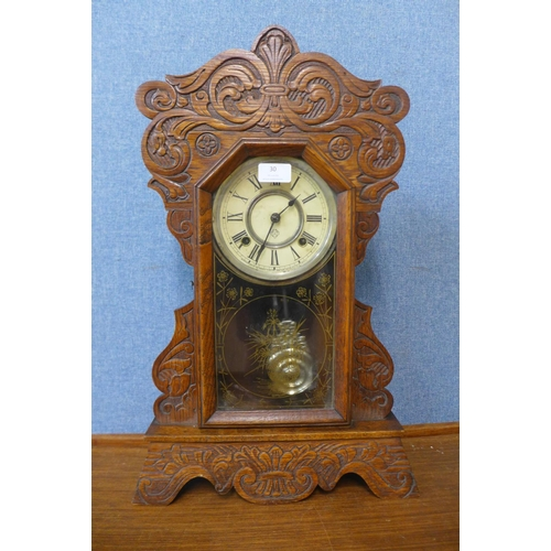 30 - A 19th Century American carved beech gingerbread shelf clock by Ansonia Clock Co....