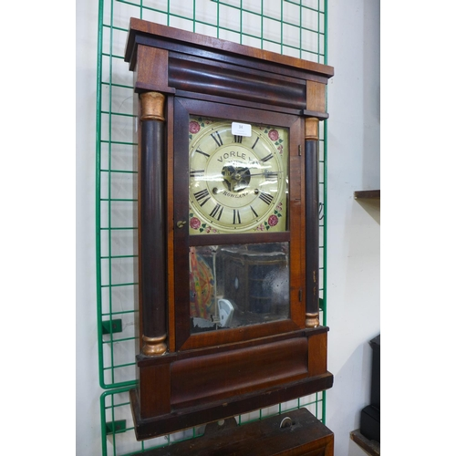 34 - A 19th Century American mahogany 30-hour wall clock by Chauncey Jerome...