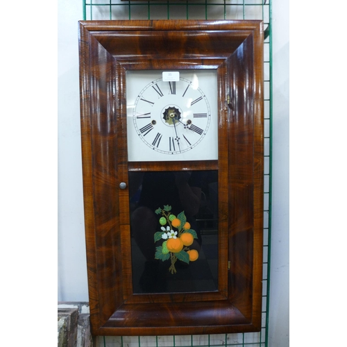 35 - A 19th Century American mahogany 8-day ogee wall clock by E.N. Welch...