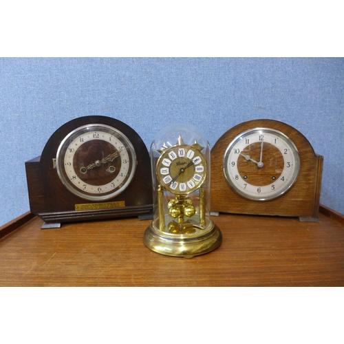 37 - Two oak mantel clocks and a brass anniversary clock...