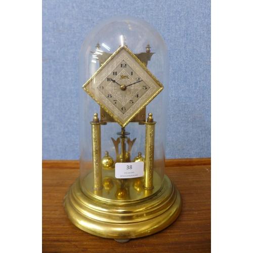 38 - A Kona brass anniversary clock...