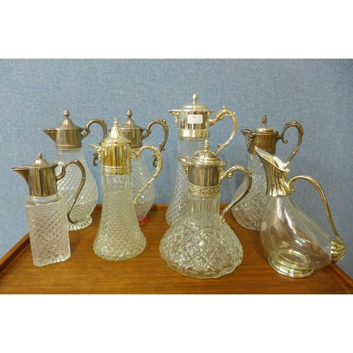 44 - Eight plated glass claret jugs...