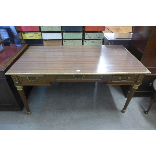 50 - A French Louis XV style mahogany, rosewood effect and gilt metal mounted bureau plat...