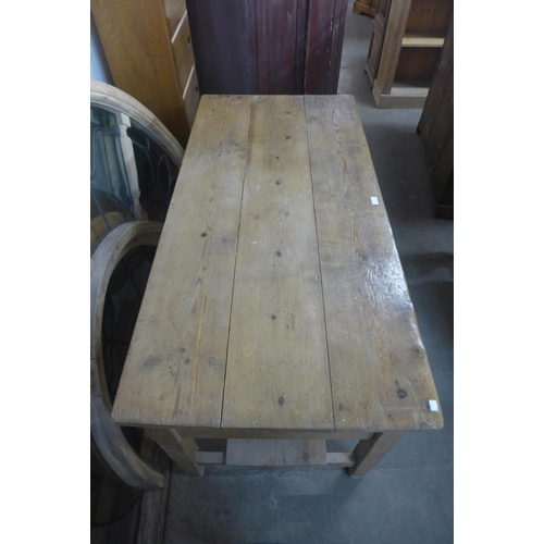 55 - A Victorian pine two drawer serving table...