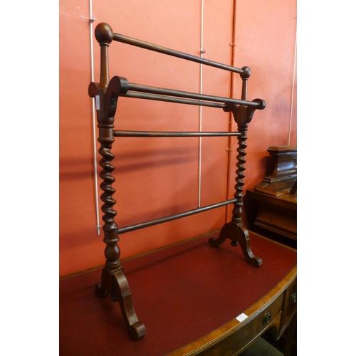 63 - A Victorian mahogany towel rail...