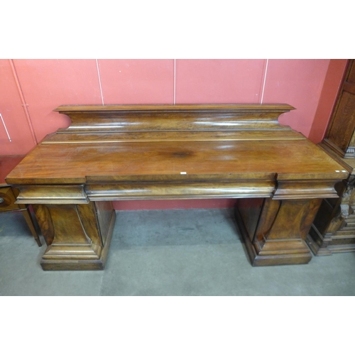 65 - A large Victorian mahogany breakfront pedestal serving table...