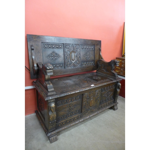 71 - A 17th Century style carved oak monk's bench...