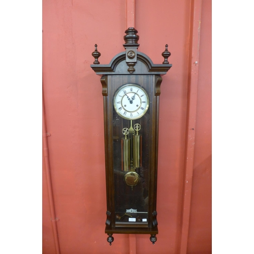 74 - A mahogany double weight Vienna wall clock...