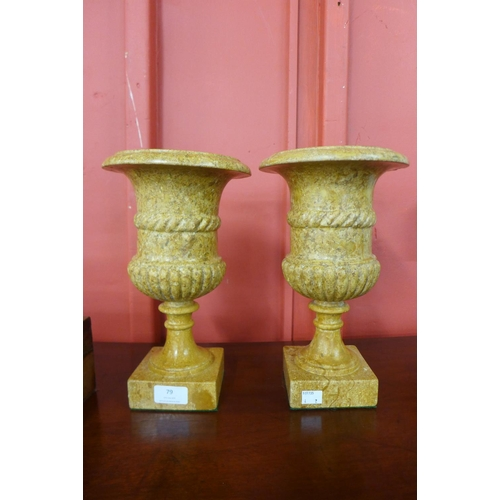79 - A pair of small 19th Century style marble campana shaped urns...