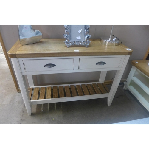 1368 - An oak and cream painted two drawer console table...