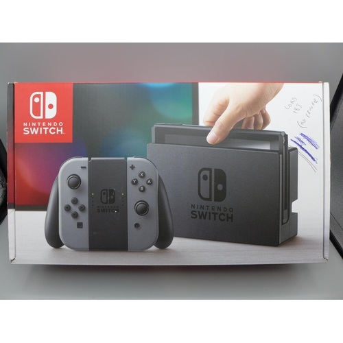 3045 - A Nintendo Switch console with controllers (no power to device) *This lot is subject to VAT...